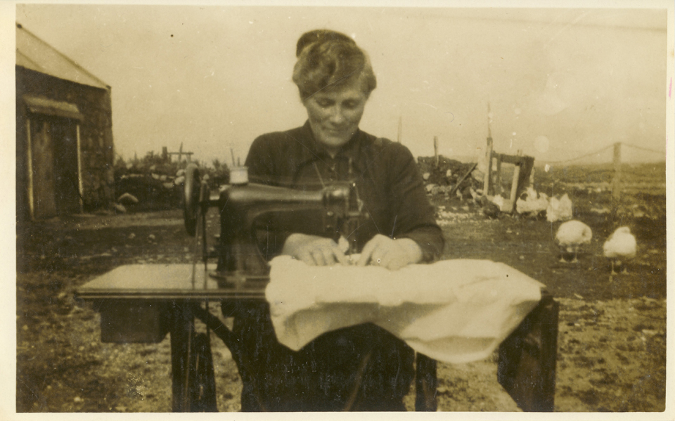 Margaret Sweeney, nee Flynn, with her sewing machine and the chickens.
